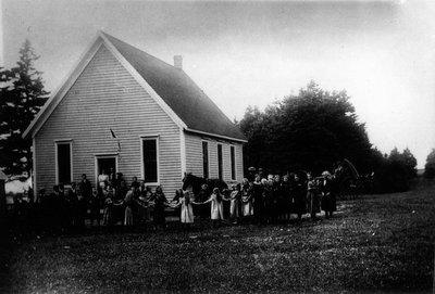 Group of children outside Cavendish school house, ca.1880's.  Cavendish, P.E.I.