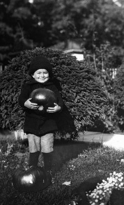 Chester with pumpkin, age 4, Oct. 1916.  Leaskdale, ON.