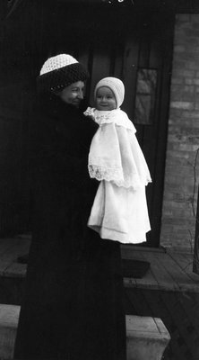 Chester in his 1st coat at 7 months.  Held by Mrs. Mustard, ca.1912.  Leaskdale, ON.