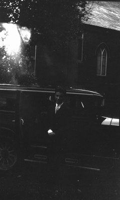 Stuart, standing beside car, 1933, Norval, ON.