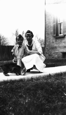 Stuart with Edith & Daffy the cat, age 19 months, ca.1916.  Leaskdale, ON.