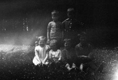 Chester & Stuart with Island children, ca.1918.