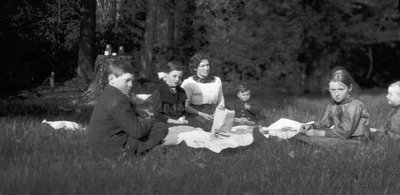 Lily & 2 children (Archie & Edith), Jessie & Cameron Leaks & Chester in Leask' woods for picnic, May 24, 1914.  Leaskdale, ON.