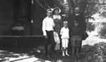 Ewan, Stuart, Chester with Mr. & Mrs. McCracken & children, ca.1920.  Leaskdale, ON.
