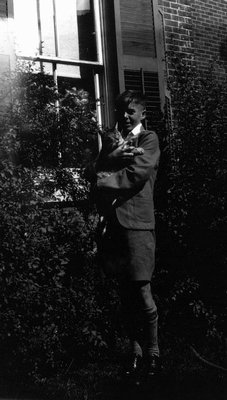 Tobie Campbell (?) with cat, ca.1928.  Norval, ON.