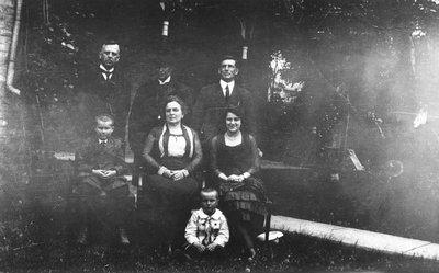 Chester, Stuart, Ewan Macdonald with Rev. Edwin Smith & family, ca.1921.  Whitby, ON. (?).