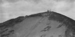 Three (unidentified) figures on Sand Dune, Cavendish P.E.I.