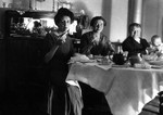 Lucy Maud Montgomery, Frede, Ewan and baby at dining table.  Leaskdale, ON.