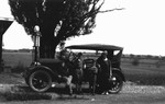 The Macdonald's first car : portrait with Ewan, Stuart, Chester, and Bertie McIntyre