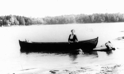 'Dreaming' - Lucy Maud Montgomery in canoe.