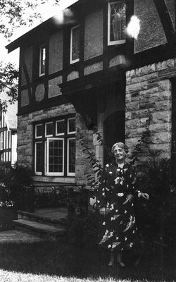 """Lucy Maud Montgomery in front of """"Journey's End"""", ca.1940. Toronto, ON."""