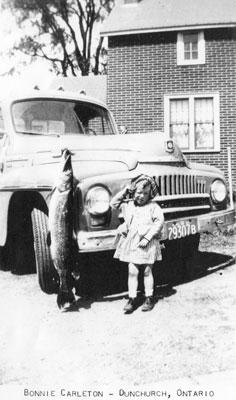 Bonnie Carleton by a Car, circa 1940