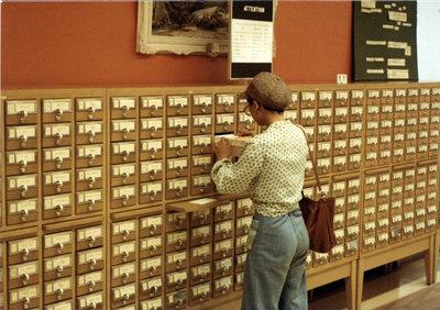 Woman using card catalogue at Wilfrid Laurier University Library