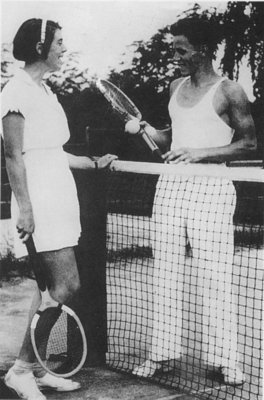 Woldemar Neufeld and Peggy Conrad playing tennis