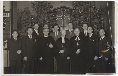 John Reble and a group of men standing in a church