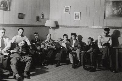 Nine male students in men's common room, Waterloo College