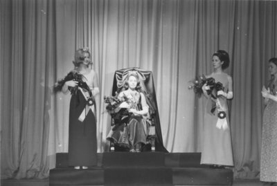 Miss Canadian University Queen on throne