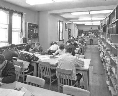Students in library, Willison Hall, Waterloo Lutheran University