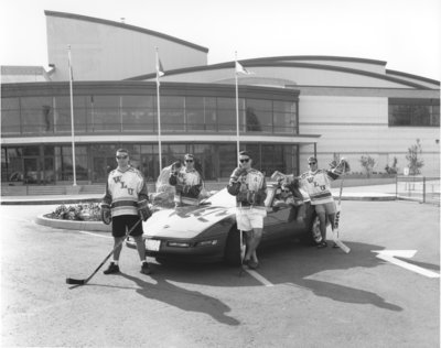 Wilfrid Laurier University hockey players in front of Waterloo Memorial Recreation Complex