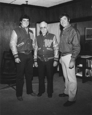 Neale Tayler receiving Lettermen's Club jacket
