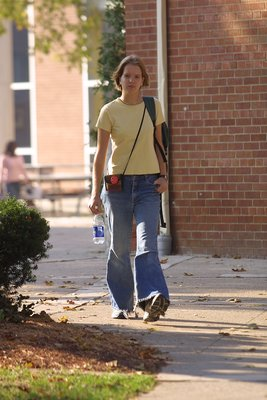 Female student walking on Wilfrid Laurier University campus