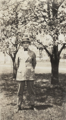 Earle Shelley standing under cherry trees