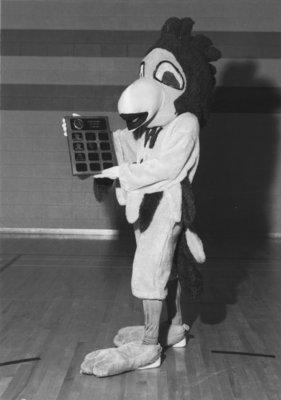 Golden Hawk mascot with award
