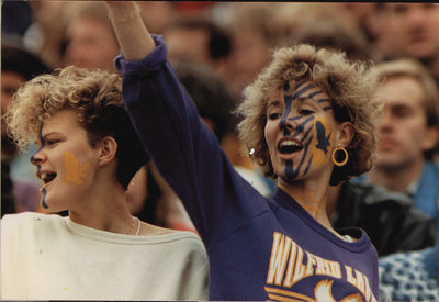 Two women at Wilfrid Laurier University football game