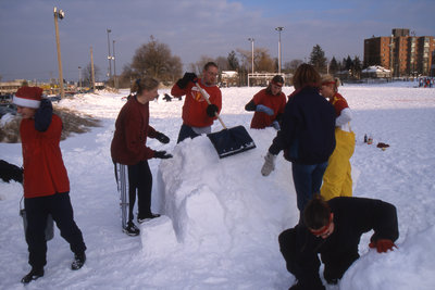 Students constructing snow sculpture, Wilfrid Laurier University Winter Carnival 1999