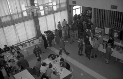 People in Waterloo Lutheran University Dining Hall during Winter Carnival 1971