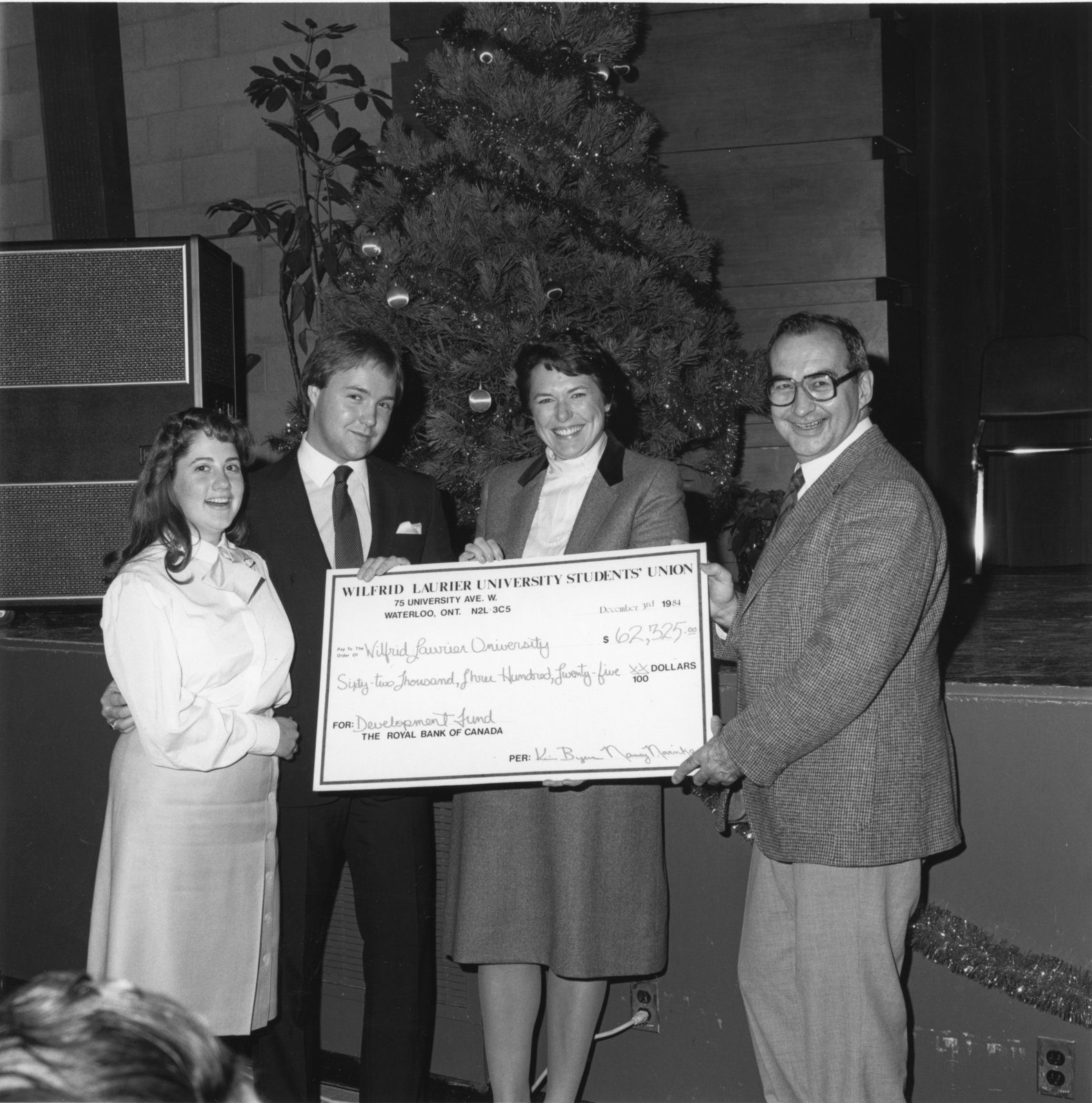John Weir and Marge Millar accepting a cheque from WLUSU