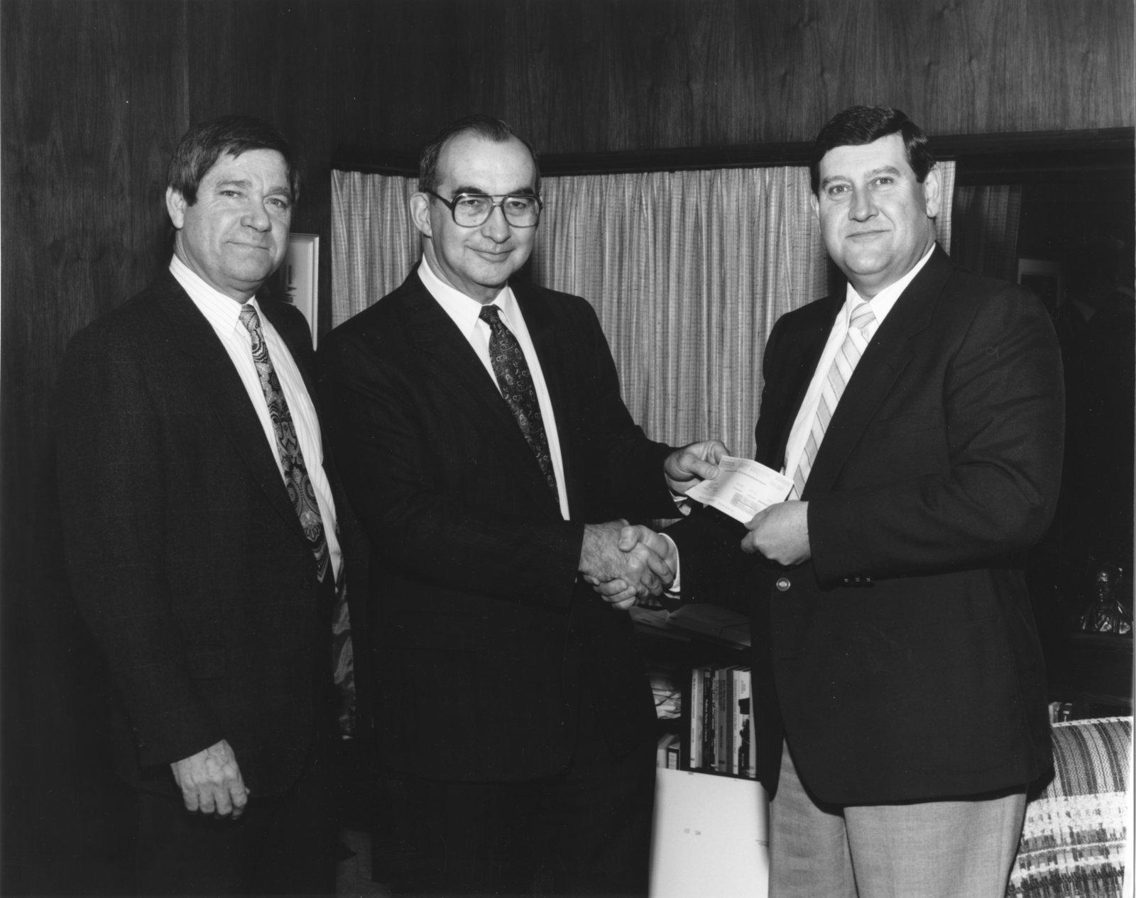 John Weir and Rich Newbrough accepting a donation from Nestlé Enterprises