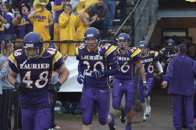 Laurier football team running on field, 2005