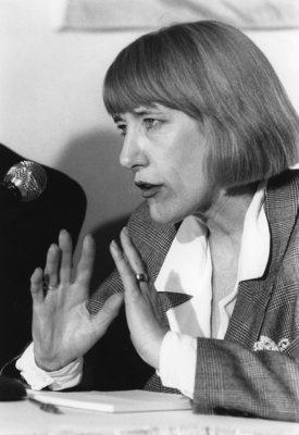 Lorna Marsden speaking into a microphone