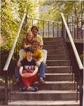 Four people sitting on outdoor stairway, Wilfrid Laurier University