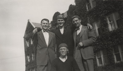 Four Waterloo College freshmen standing in front of Willison Hall