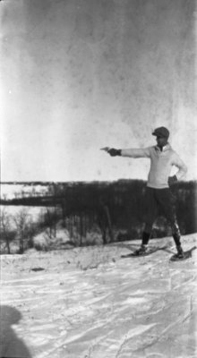Earle Shelley holding a gun