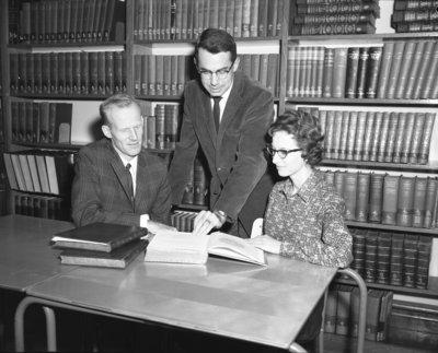 Three people in Waterloo Lutheran University Library