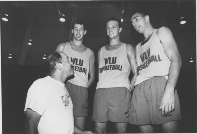 Wilfrid Laurier University basketball players with head coach