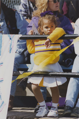 Young girl taking in a Homecoming football game