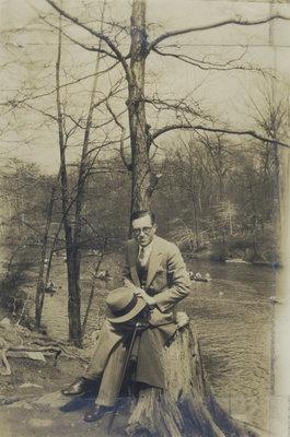 Wilfrid Schweitzer sitting on a tree stump