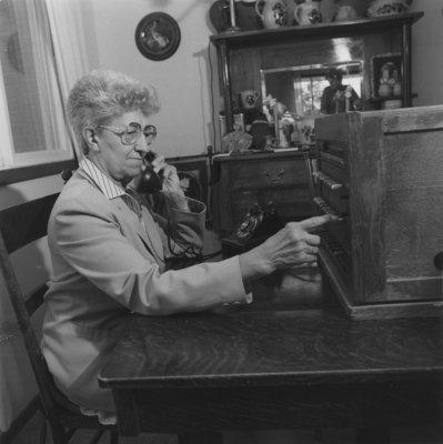 Verna Glebe using antique telephone switchboard