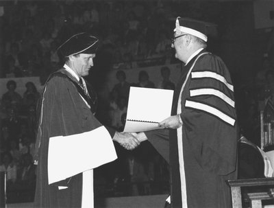 Jean Chrétien and John Black Aird shaking hands at convocation