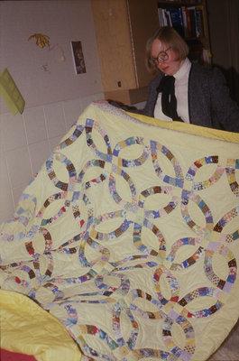 Tina Matiisen holding a quilt