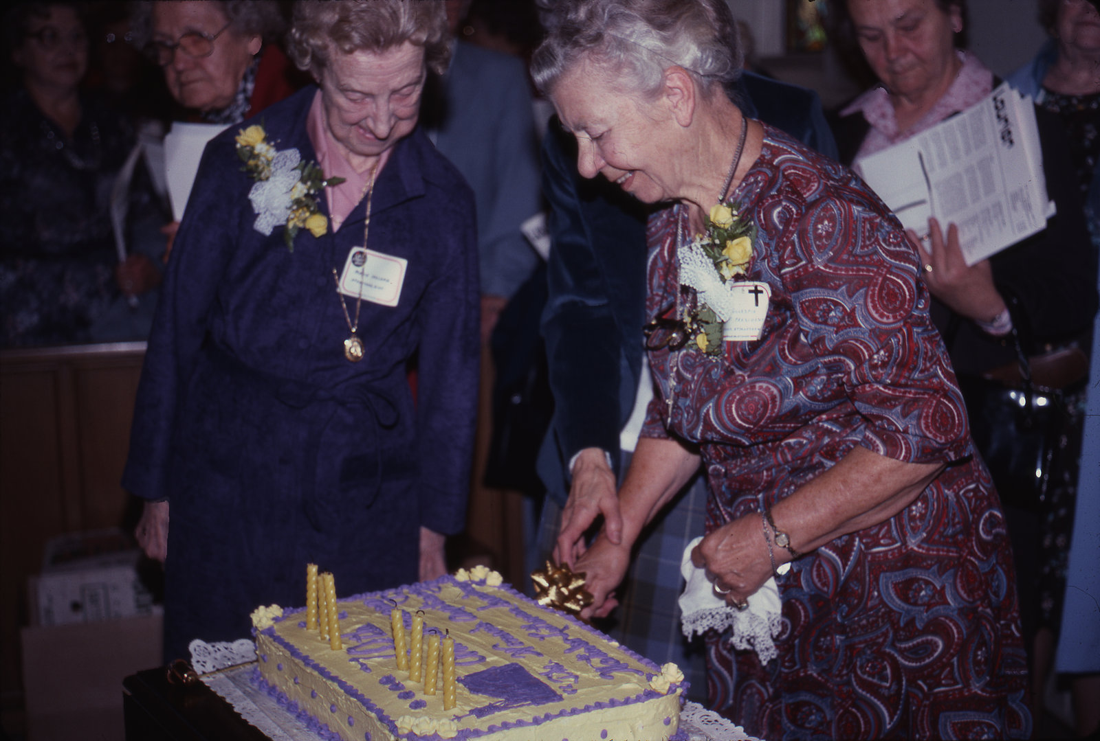 Ruth Gillespie and Marie Ireland with the Women's Auxiliary anniversary cake