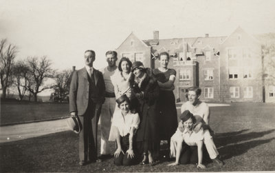 Frederick B. Clausen with seven people