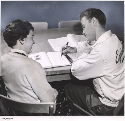 Two Waterloo College students seated at a table