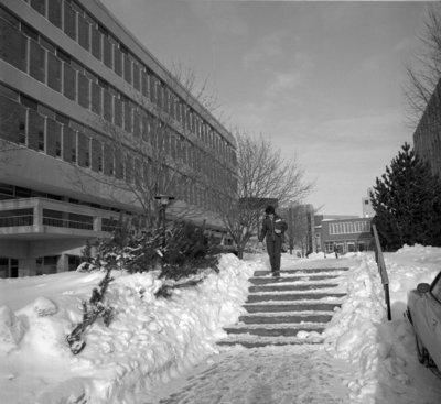 Woman walking on Wilfrid Laurier University campus