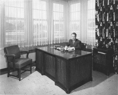 Lloyd Schaus sitting at a desk