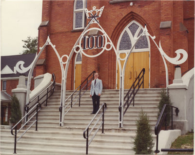 Man standing in front of Zion Lutheran Evangelical Church in Pembroke, Ontario